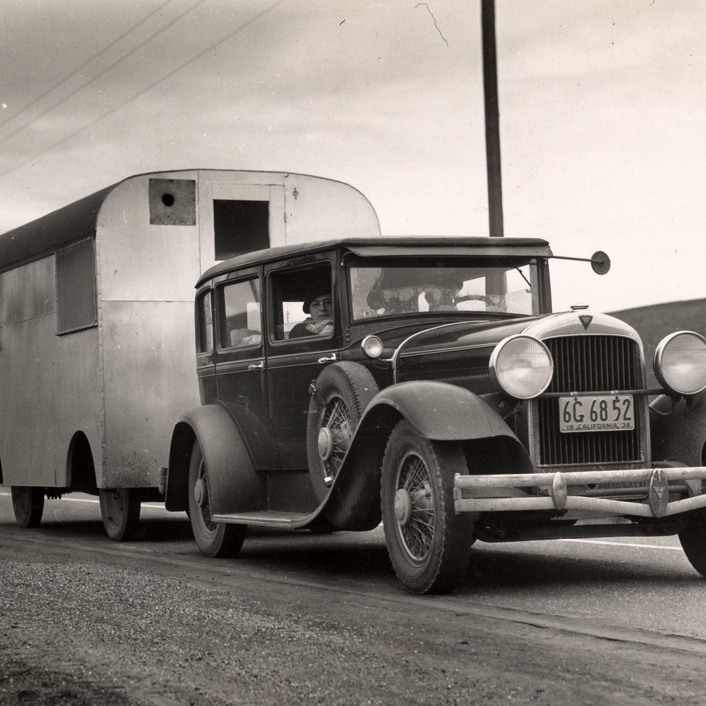 Car and homemade trailer on U.S. 101 by Dorothea Lange