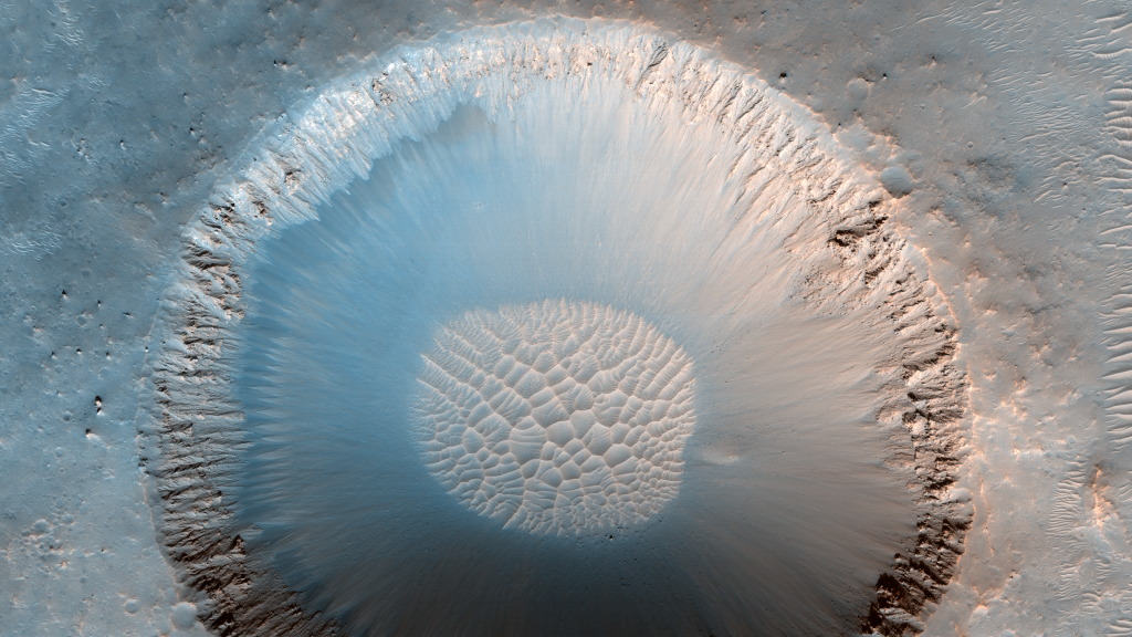Crater with Steep Slopes in Meridiani Planum  by NASA