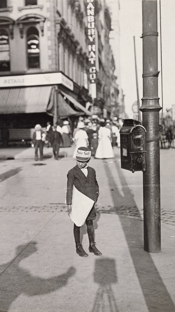 Self-Portrait with Newsboy by Lewis Hine